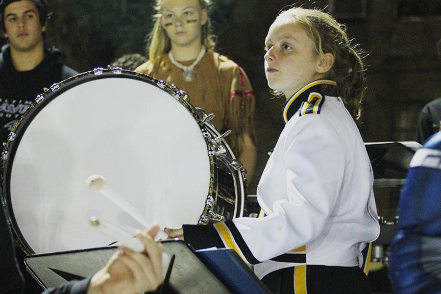 Sophomore+Emma+Gromacki+plays+the+bass+drum+at+the+Homecoming+football+game+on+Oct.+24.+Gromacki+has+participated+in+drum+line+during+both+of+her+years+at+JC.