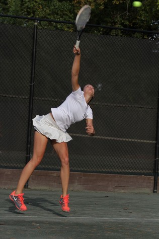 Junior singles player Luisa Schulte serves the ball. Schulte won the IAAM singles number two championship.