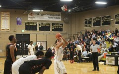 Men's basketball runs the court, Wrestling team fights to top of state