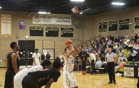 Sports Updates: Men's basketball runs the court, Wrestling team fights to top of state