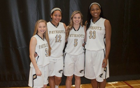 Sisters pair up in varsity basketball