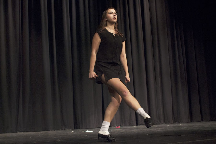 Senior+Casey+Smial+performs+an+Irish+dance+routine+wearing+hard+shoes.+She+has+been+Irish+dancing+ever+since+she+was+six+years+old.+