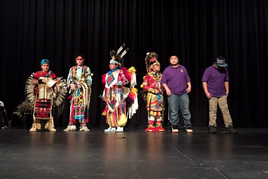 Students from St. Labre Indian School take the stage after a brief presentation about traditional Native American music and dance styles. Dancers and drum group members performed in The Morning Star Powwow on Jan. 9.