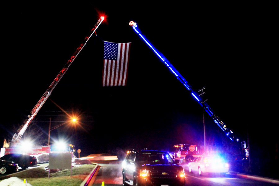 The American flag hangs solemnly from two firetrucks above the entrance of Mountain Christian Church. The flag stood to honor Senior Deputy Patrick Dailey's visitation that Tuesday night on Feb.16 after he was fatally shot at the Panera Bread in Abingdon, Md on Feb. 10.