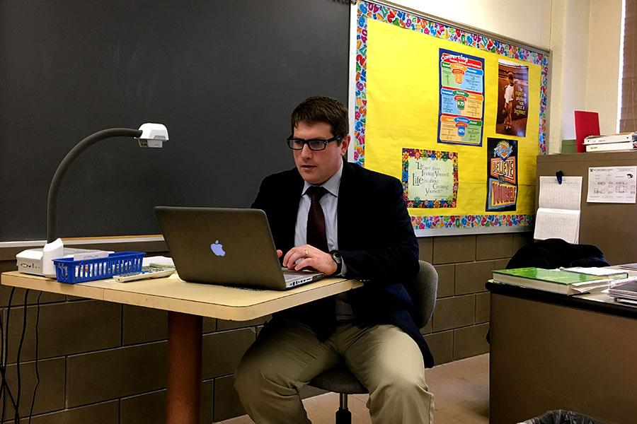 During class, Vice Principal of Technology and Student Affairs Brian Powell searches for political ad campaign videos to teach his AP Government and Politics students. Powell, along with being a teacher, is an administrator, has a side design company, and farms as a hobby.