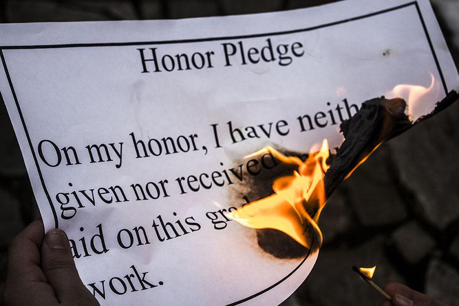 The honor code is too weak to stop the trend of cheating in high schools. In order to keep JC honest a, new, tougher honor code should be adopted.