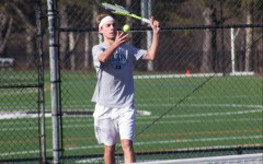 Senior tennis players connect on the court