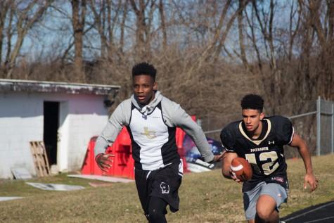 Football players race into new season