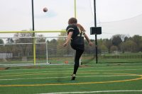 Female athlete kicking down gender barriers