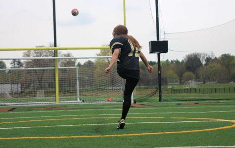 Female athlete kicking down gender barriers
