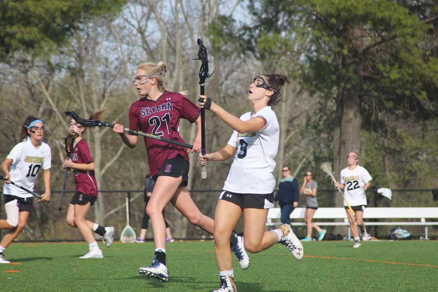 Senior varsity women's lacrosse defenseman Anya McSorley passes the ball down the field on a fast break. McSorley committed to play lacrosse at Coastal Carolina University on Oct. of 2014 in her junior year.