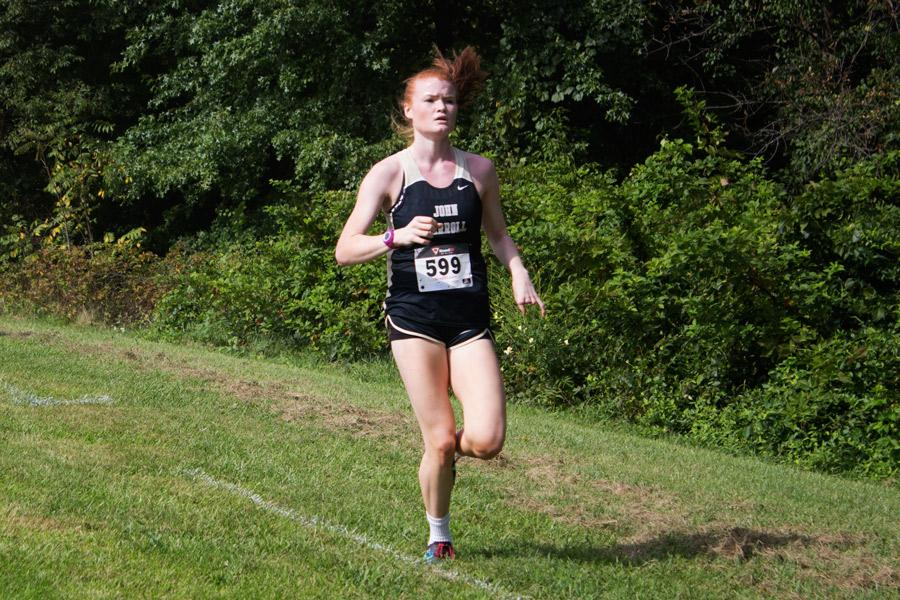Junior Rosemary Gillam digs deep on the final stretch as she races in the Mustang Invitational, a two-mile course, on Sept. 2. Gillam won third place overall and was JC's top runner with a time of 12 minutes and 27 seconds.