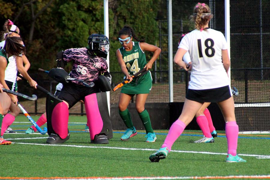Looking back to find the ball, senior goalie Emma Gromacki helps lead her team to victory in a critical game against Indian Creek on Oct. 13, 2015. Gromacki was named The Baltimore Sun Player of the Week and was included in the USA Today's ALL-USA Performances of the Week.