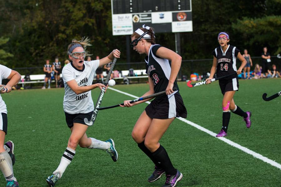 Senior center midfielder Charlotte Haggerty tries to stop the ball in mid air during the game against Maryvale on Monday, Oct. 17. The varsity field hockey team was defeated by Maryvale in the game that determined who held first place for the IAAM B Conference.