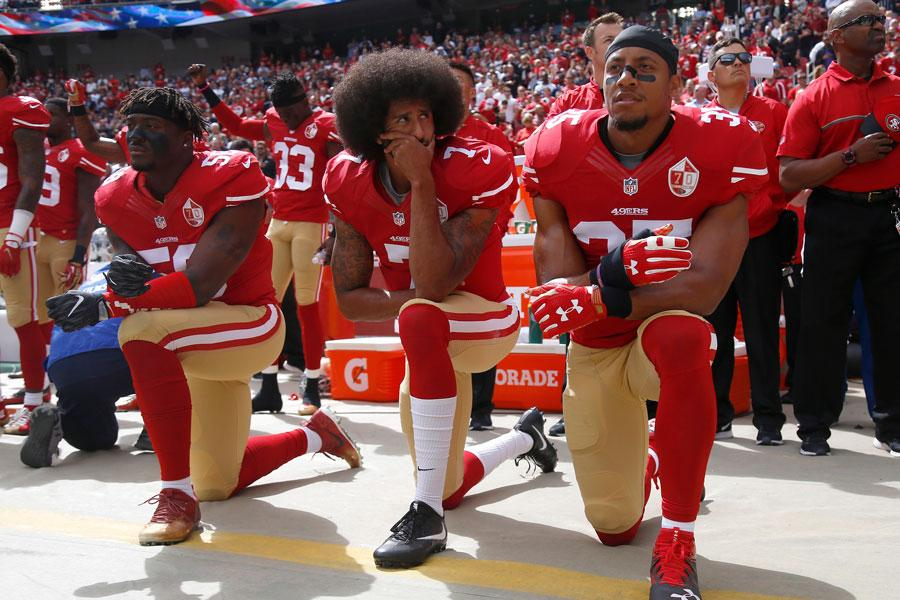 From left, the San Francisco 49ers' Eli Harold, Colin Kaepernick and Eric Reid kneel during the national anthem before their NFL game against the Dallas Cowboys on October 2, 2016, at Levi's Stadium in Santa Clara, Calif.