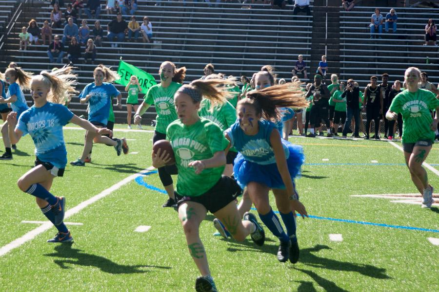 Senior Charlotte Haggerty runs with the ball while being chased by junior Marisa DiFonso during the Powerdpuff game. The annual Powderpuff game between the juniors and the seniors took place on the Friday of Spirit Week, and the seniors won 21-14.