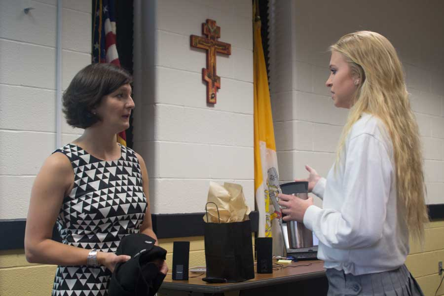 Senior Beth Sapitowicz talks to Chantal Buscher Kelley, class of '01, after Buscher spoke to the Entrepreneurial Studies classes about how JC prepared her for her future job. Buscher currently works at the International Olympic Committee and helps Olympic athletes find jobs once the Olympics are over.