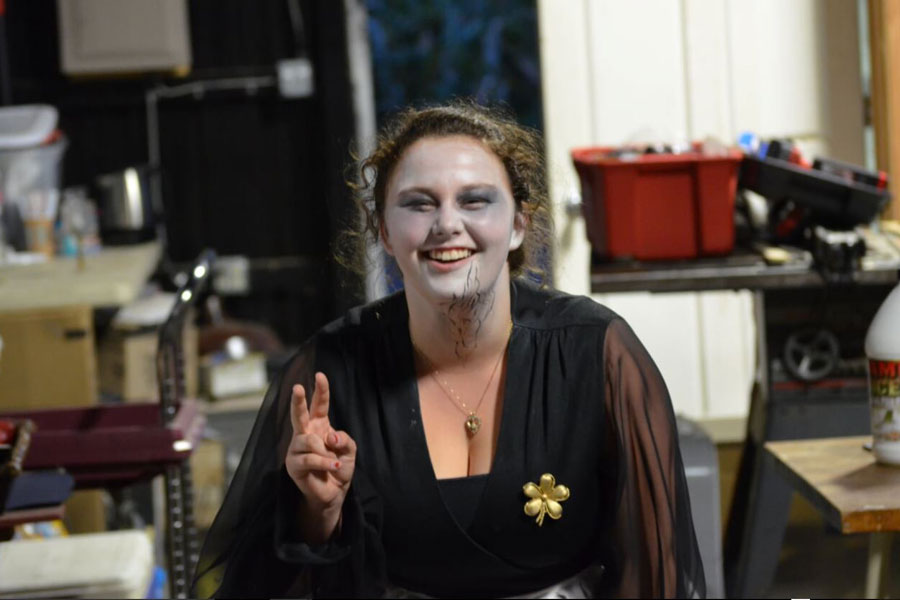 Senior Taylor Dorris poses after getting her makeup done at Legends of the Fog. Dorris volunteers there every weekend and plays the role of a dead bartender in the Farewell Hotel.