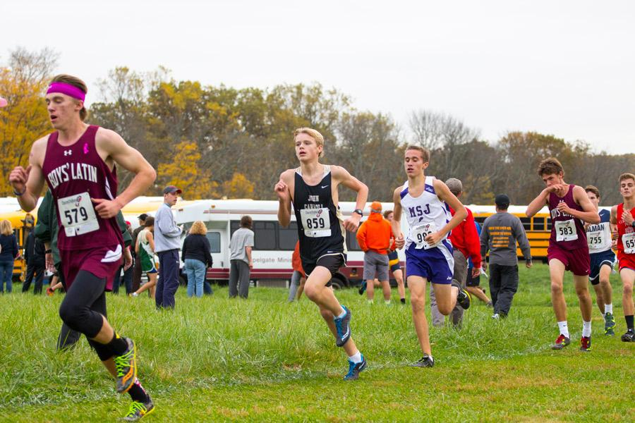 Sophomore Alexander Kirkland keeps pace with the top runners during the MIAA Cross Country Championships on Nov. 1. The men's cross country team placed second in the varsity B Conference with a score of 60 points.
