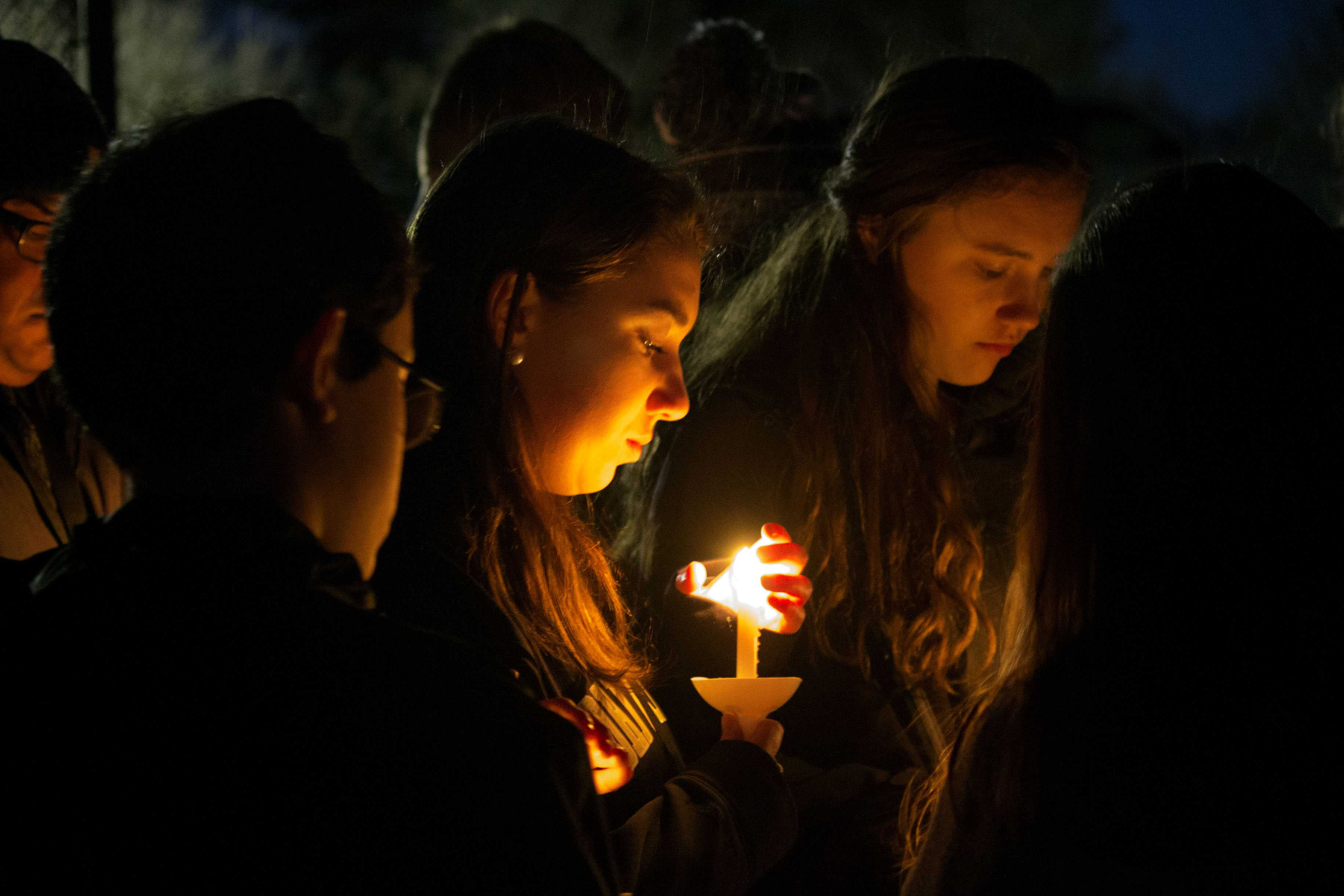 A student holds a candle in memory of sophomore Josh Hamer at the candlight vigil on Thusday, March 2. In addition to the vigil, students united together on Monday March 6, the community held a prayer service to honor and celebrate Josh's life.
