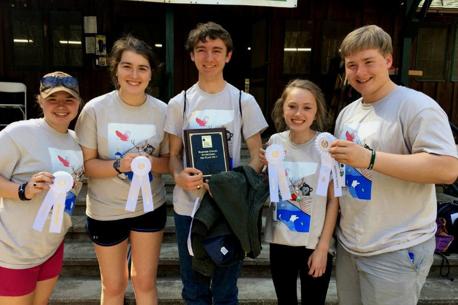 Seniors+Mary+Olsen%2C+Elizabeth+Butz%2C+Edward+Benner%2C+Erica+Deyesu%2C+and+Caleb+Olsen+pose+with+their+awards+from+the+Harford+County+Envirothon+competition+at+Rocks+State+Park.+The+A+Team+won+third+place+for+the+second+consecutive+year.