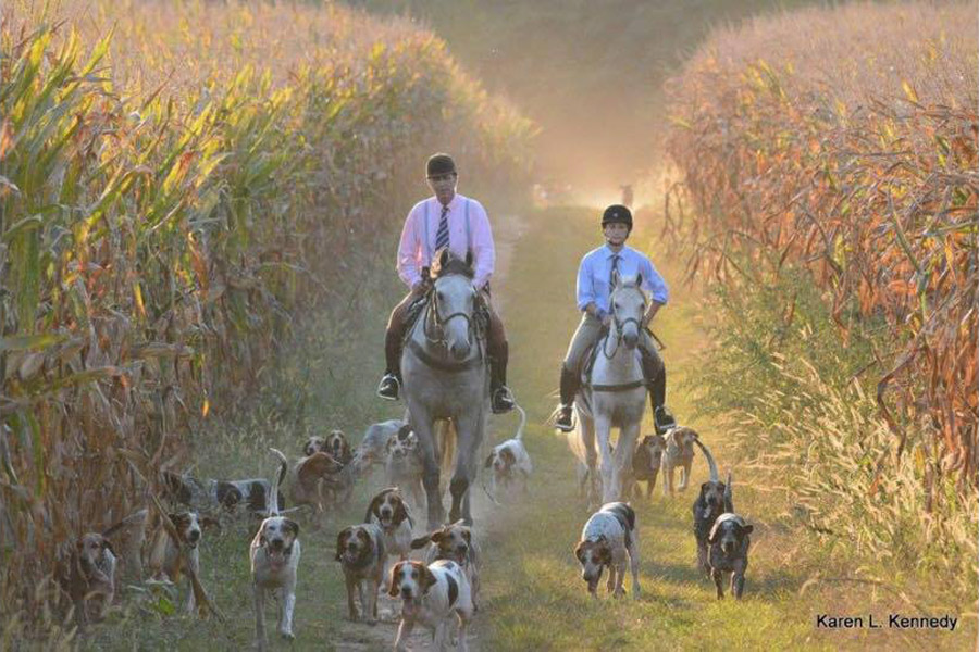 Senior Taylor Crews (right) and the Master of the Hunt ride during a foxhunt, which includes the use of hounds who catch a fox while riders follow behind them. Crews has been foxhunting since she was 11 years old and has recently joined Elkridge Harford Hunt Club.