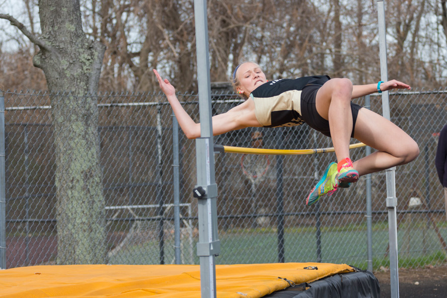Junior Ashlee Kothenbeutel jumps over the bar with height to spare in the high jump. Kothenbeutel tied for second place with a height of 4'10