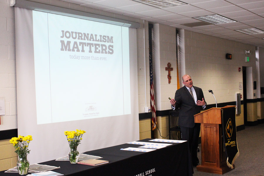 Publisher and Editor in Chief of The Baltimore Sun Media Group Triffon Alatzas speaks during the induction ceremony for the Quill and Scroll Honor Society. Alatzas shared stories about his journalistic experiences and explained how the different publications within the media group operate.