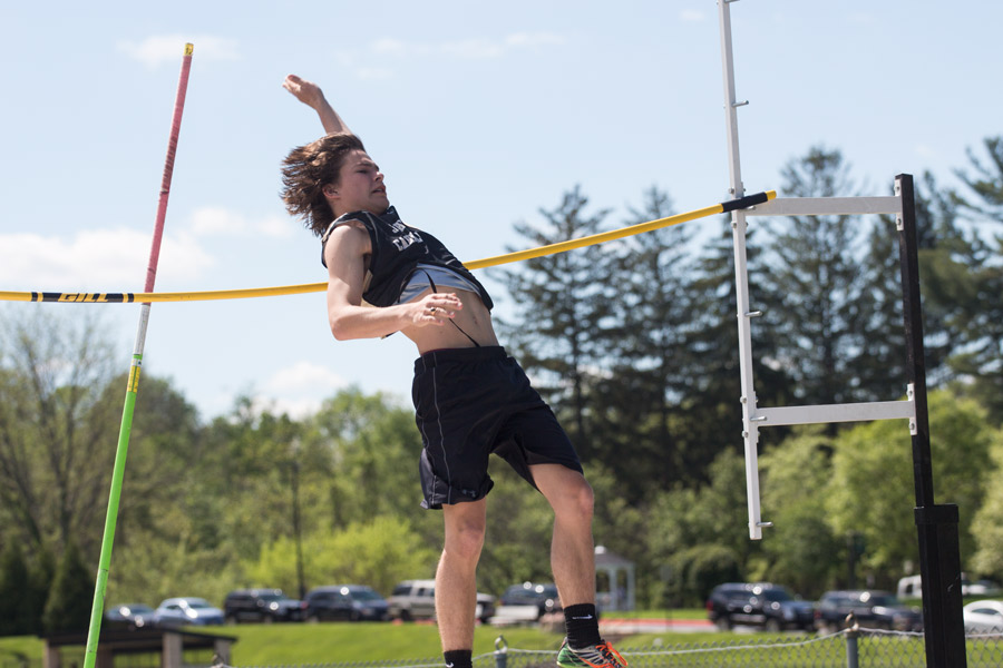 Junior+Jared+Vogel+flings+himself+over+the+pole+vaulting+bar.+The+MIAA%2FIAAM+championships+prelim+took+place+on+Wednesday%2C+May+10%2C+at+our+home+track.