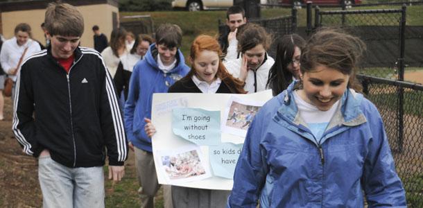 Students walk barefoot to raise awareness