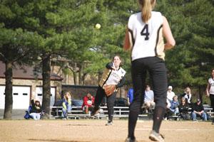 Softball team adjusts to playbook change
