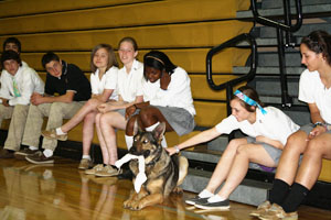 Rodney Johnsons U.S. Government class gathers around Bruno the police dog. Johnson had Officer Marty Hoppa bring in Bruno to demonstrate how law enforcement works.