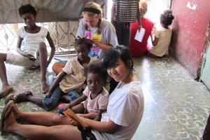 Senior helps at Haitian orphanage