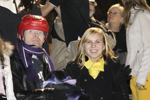 Senior Dana Grimmel and her friend from the Gallagher Services enjoy the football game