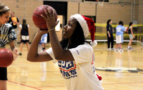 Women's basketball teams raise money for families in need
