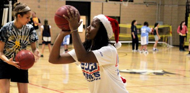 Womens basketball teams raise money for families in need