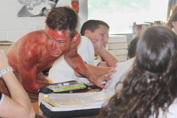 Sophomore Austin Kiss terrorizes fellow students in an English class presentation of the Hamatsa dance.