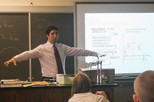 New physics teacher Jorge Piquer teaches juniors and seniors about the velocity of certain objects. In his Honors Physics class, Piquer shows a powerpoint of the key concepts his students must know.