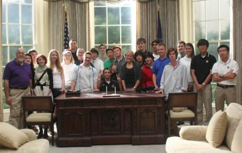 The journalism and TV production class pose on an Oval Office set.  This is part of the