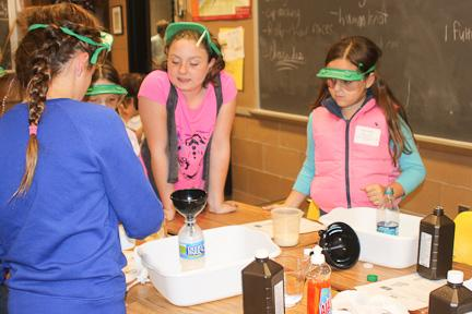"On Oct. 9, John Carroll hosted STEM Night and Beyond. While there, elementary school students from local private schools participate in an expirament called ""Elephant Toothpaste."""