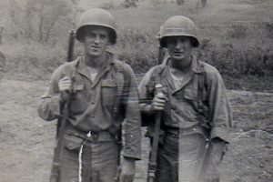 Russian teacher Ed Miller (right) served in the US Army for three years. Miller was stationed in Austria for two years.