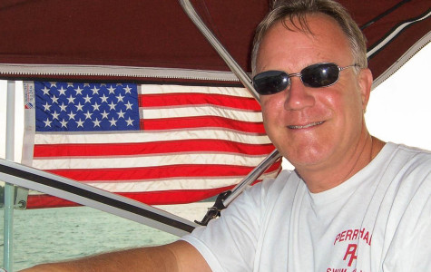Math teacher Alvin Ward pictured on his boat, The Relation Ship. Ward enjoys vacationing on the water and water skiing.