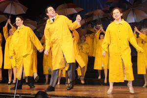 """(From left to right) Sophomore Brady Fritz, senior Thomas Gardner, and junior Karly Horn perform the final song of """"Singin' in the Rain."""" The Theatre Department will travel to Disney World to perform four numbers from the production."""