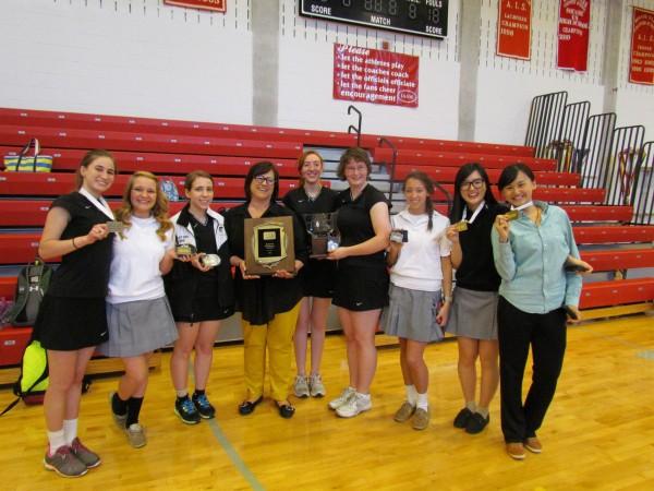 Badminton team brings home championship