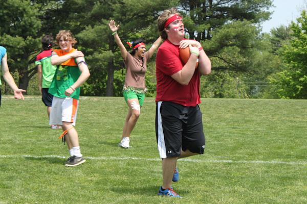 Senior Ryan Isom gets ready to run with possession of the football during a game of flag football.