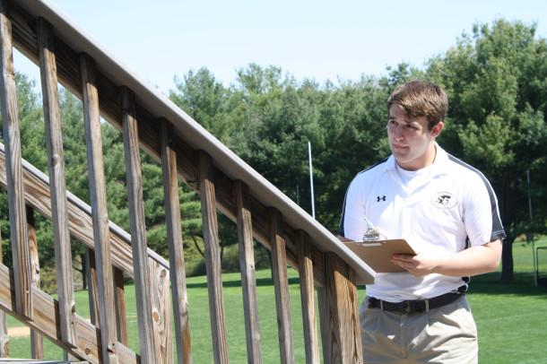 Senior Daniel Kelble studies the pressbox for his Senior Project.  Kelble is building is building a new pressbox and will begin the construction in early May.