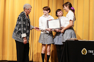 (From left to right) Principal Madelyn Ball awards The Patriot chiefs seniors Martha Schick, Brianna Glase, and Emily Clarke with the CSPA Silver Crown Award. According to the CSPA website, the Silver Crown is one of the most prestigious awards given by the CSPA.