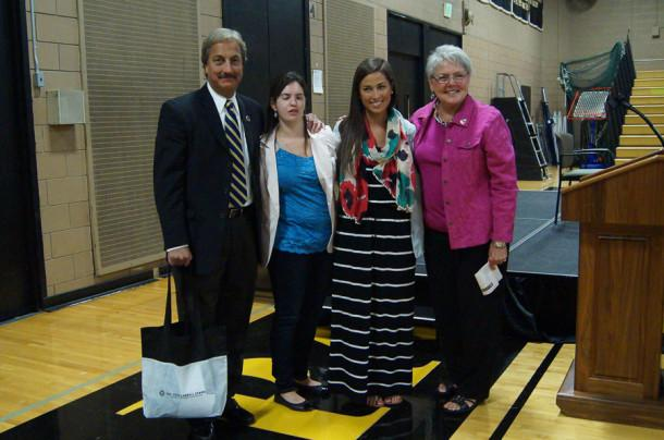 President Richard O'Hara, Elizabeth Puleo, Meg O'Hara, and Principal Madelyn Ball pose after Puleo's speech. Puleo visited JC as a guest motivational speaker.