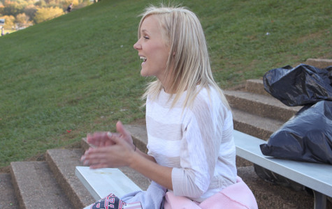 Cheerleading coach Kari Patchak, class of '07, claps for the JV girls during a football game on Oct. 24. Patchak was a cheerleader for four years at JC.