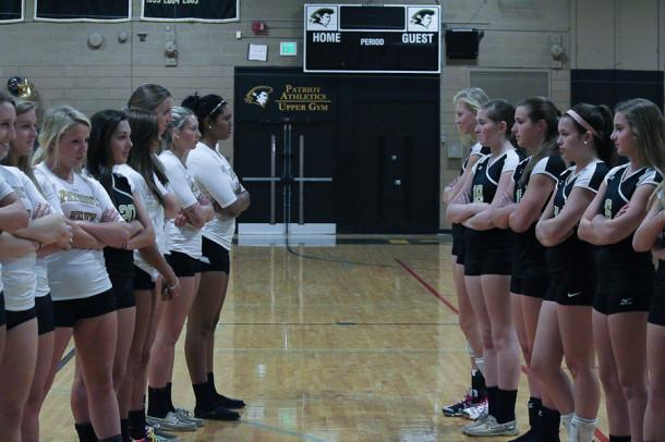 Varsity+and+JV+volleyball+girls+face-off.+In+a+Patriot+survey%2C+47.6+percent+of+students+agree+that+varsity+teams+get+more+attention+than+JV+teams.